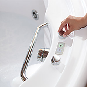 Person running a bath with instant hot water from tankless water heater
