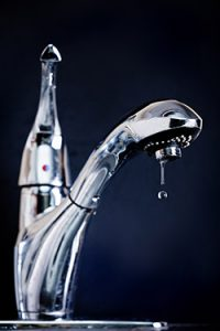 Indoor water faucet dripping water to avoid frozen pipes