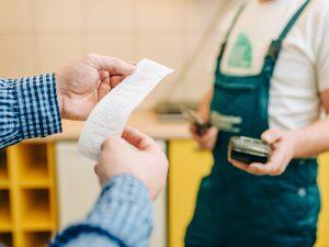 Hands holding receipt.